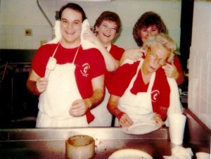 The dishwashing crew of Gil Ward, Jane Schulte, Sharon Heidelberg and Monta Jo Johnson clown around at the 26th Annual Pancake Supper. From the March 13, 1987 church newspaper.
